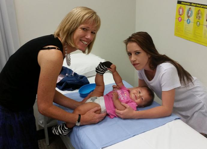 Practice Nurse Sue Stevenson with mum Tyler Barrett and her baby Nadia Barrett- Thomas