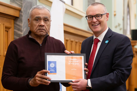 Minister of Health Dr David Clark with David Ratū, 2019 Health Volunteer of the Year.