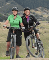 Cherie Ruscoe, and Dawn Wilsonon their bikes