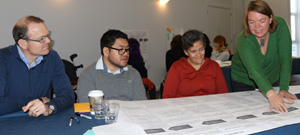 Photo of the workshop participants listening to someone.