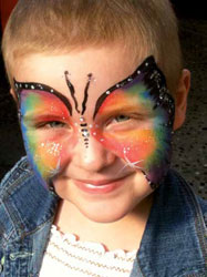 Photo of Shauna, with a butterfly painted on her face.
