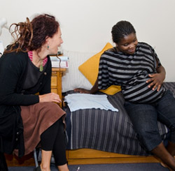Photo of a pregnant woman meeting with her lead maternity carer.
