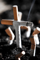Photo of cigarettes in the shape of a cross.